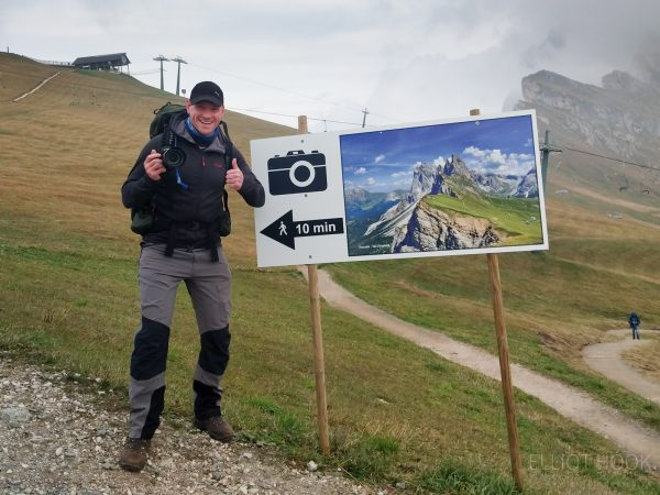 Seceda sign directing photographers to the view, Dolomites