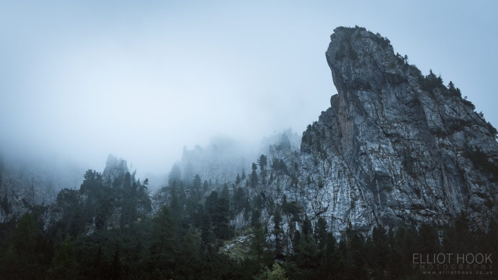 A clouded mountainside along Sella Pass, Dolomites