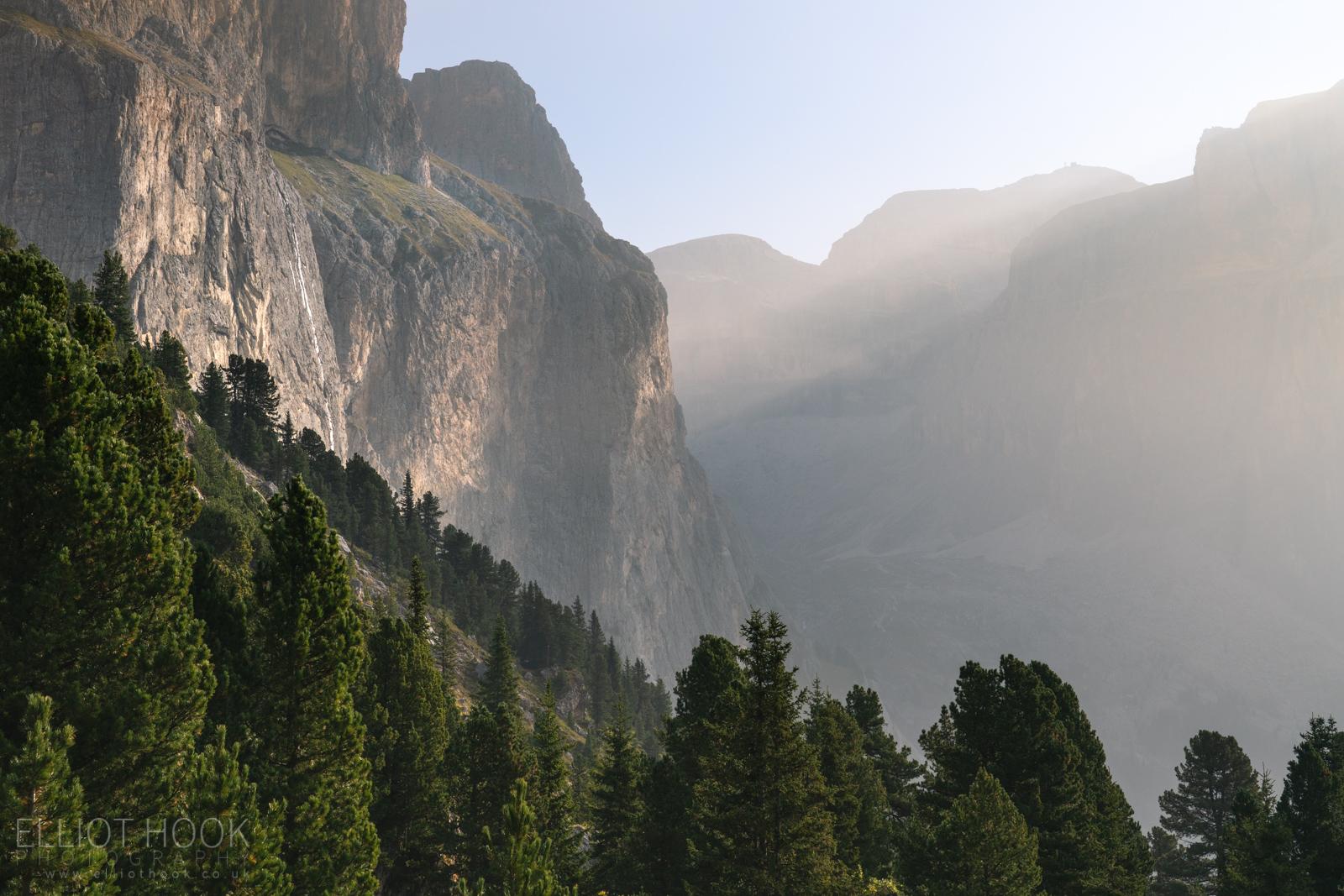 Light hitting the woodland hillsides of Sella Pass, the Dolomites